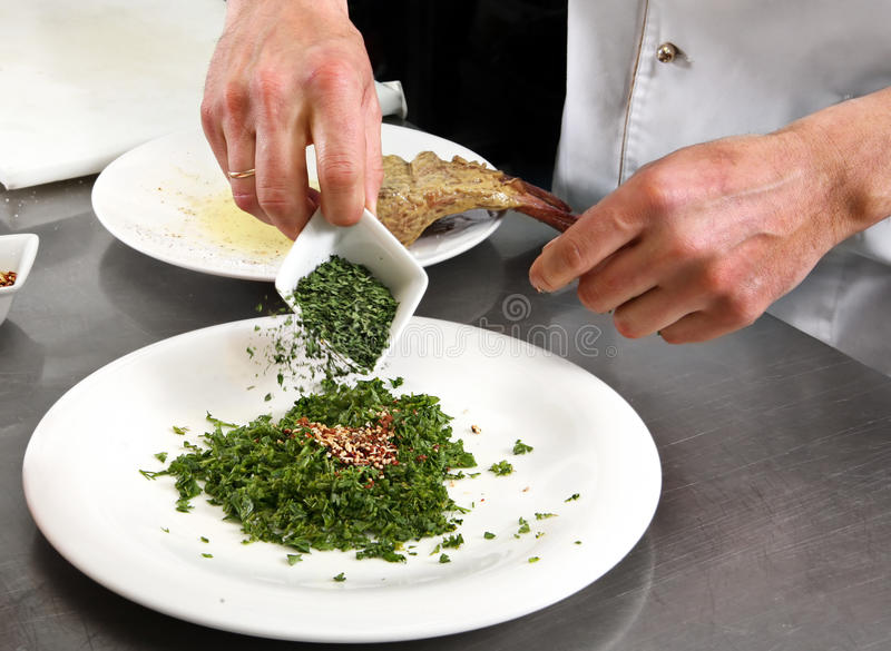Chef mixed herb and spice. For meat royalty free stock photos