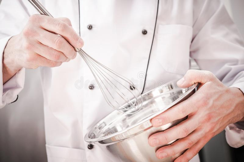 Chef Mixing Ingredients royalty free stock image