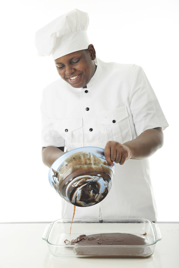 Chef Pouring Batter images stock