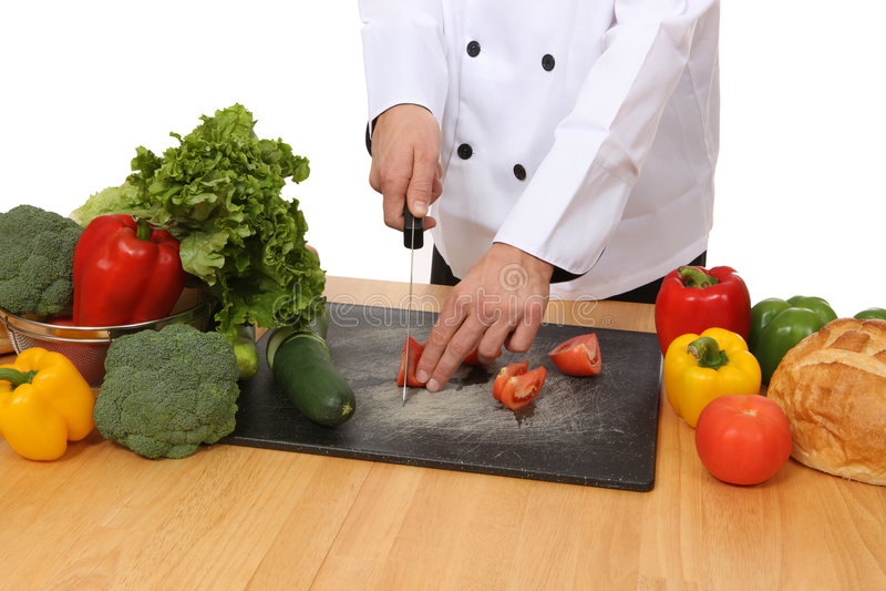 Chef préparant la nourriture photo stock