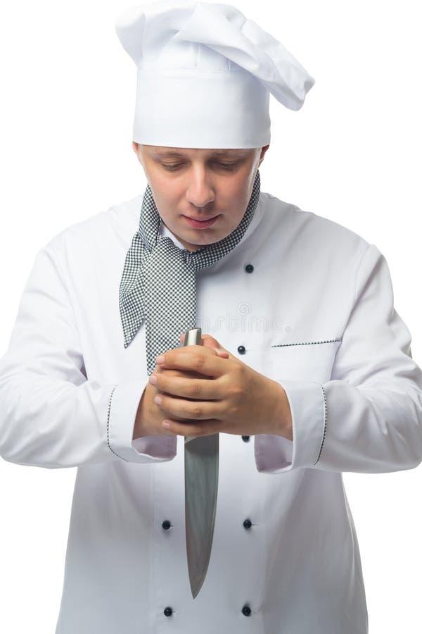 Chef prêt à couper les produits pour la cuisson image libre de droits