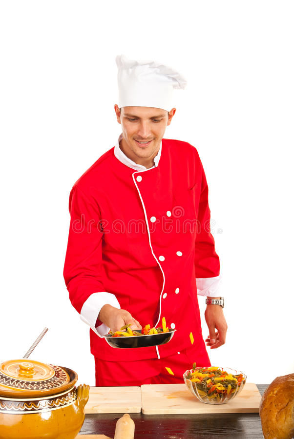 Chef prepare macaroni in pan. Chef male preparing macaroni in frying pan in kitchen stock images