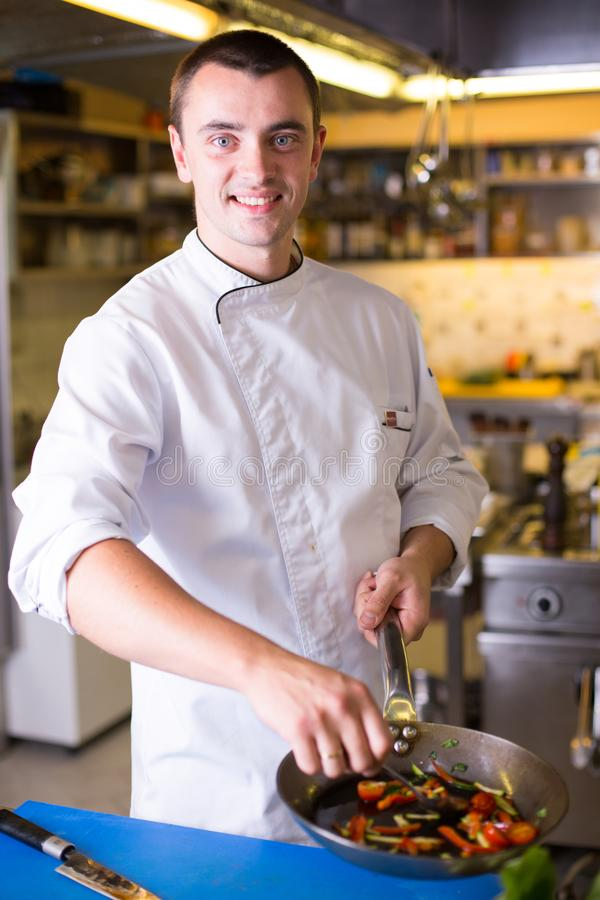 The Chef prepares food royalty free stock photos