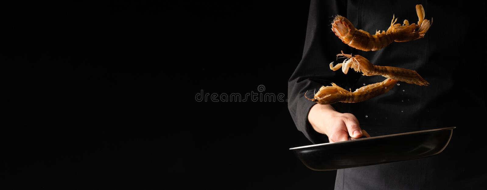 Chef prepares sea food, mantis shrimp, East Asian cuisine, dilikates, on a black background, horizontal photo, banner.  royalty free stock images