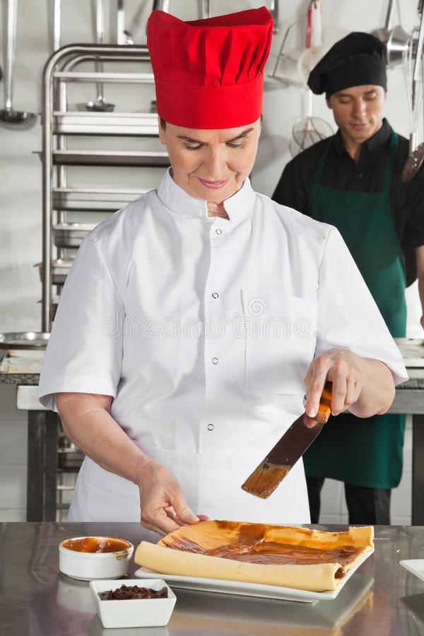 Chef Preparing Chocolate Roll royalty free stock image