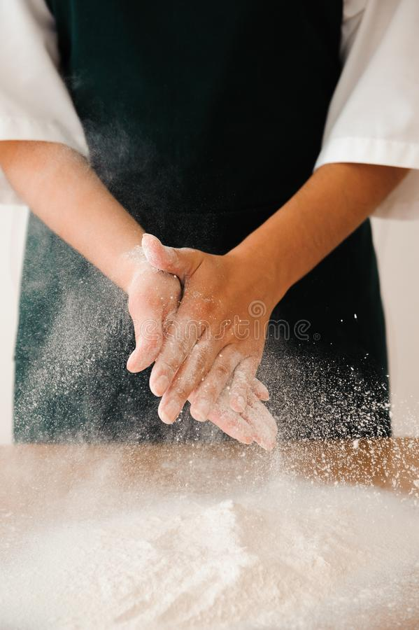 Chef preparing dough - cooking process, work with flour. Chef preparing dough - cooking process stock photo