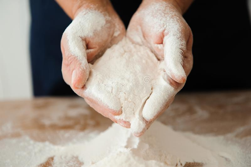 Chef preparing dough - cooking process, work with flour. Chef preparing dough - cooking process royalty free stock images