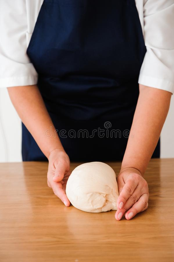 Chef preparing dough - cooking process, work with flour. Chef preparing dough - cooking process royalty free stock photography