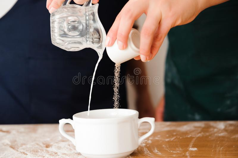 Chef preparing dough - cooking process, work with flour.  royalty free stock images