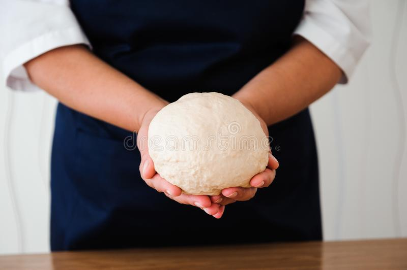 Chef preparing dough - cooking process, work with flour.  royalty free stock photo