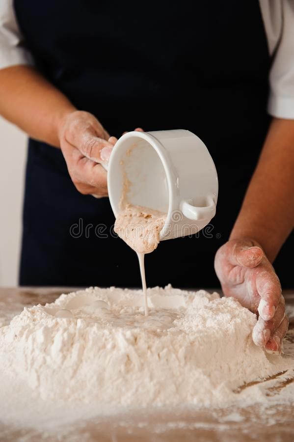 Chef preparing dough - cooking process, work with flour. Chef preparing dough - cooking process stock image