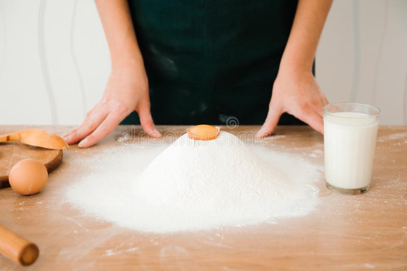 Chef preparing dough - cooking process, work with flour. Chef preparing dough - cooking process stock images