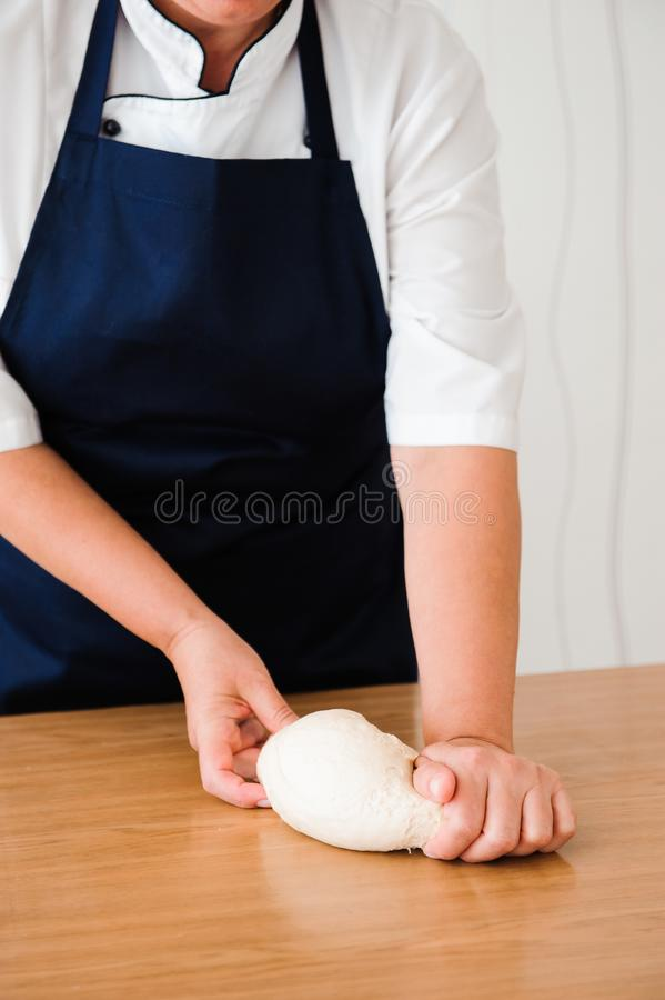 Chef preparing dough - cooking process, work with flour. Chef preparing dough - cooking process royalty free stock image