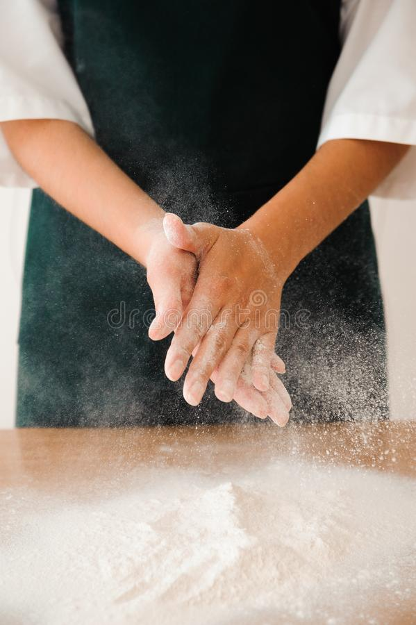 Chef preparing dough - cooking process, work with flour. Chef preparing dough - cooking process stock photography