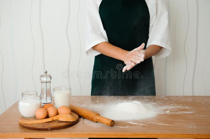 Chef preparing dough - cooking process, work with flour.  stock photography