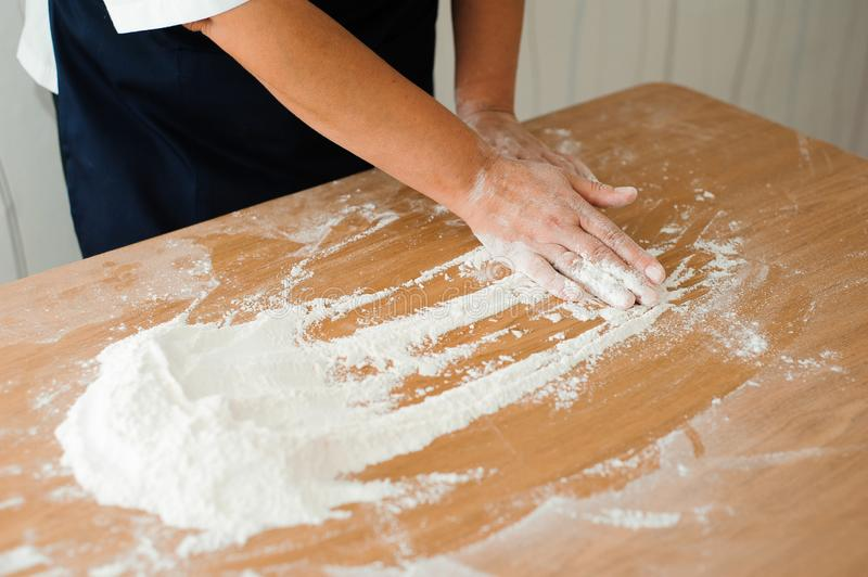 Chef preparing dough - cooking process, work with flour.  stock photo