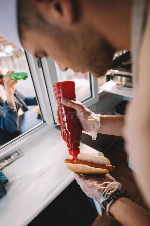 Chef preparing hod dog. In food truck royalty free stock images