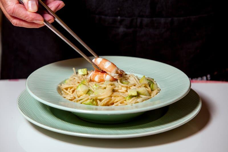 Chef preparing pasta stock photo