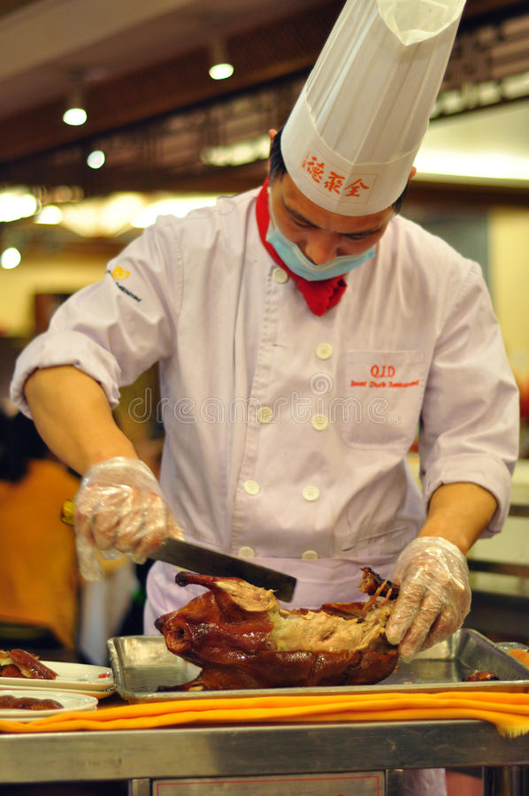 Chef preparing Peking Duck at Quan Ju De, Beijing. Quanjude (Chinese: 全聚德) SZSE: 002186 is a famous Chinese restaurant known for its trademark stock images