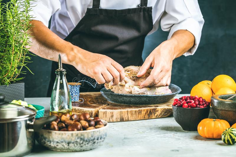 Chef preparing stufet duck in kitchen or market for christmas. royalty free stock image