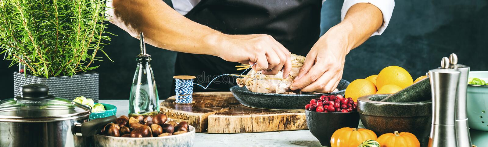 Chef preparing stufet duck in kitchen or market for christmas. royalty free stock images