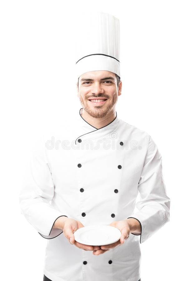 Chef presenting a dish stock images