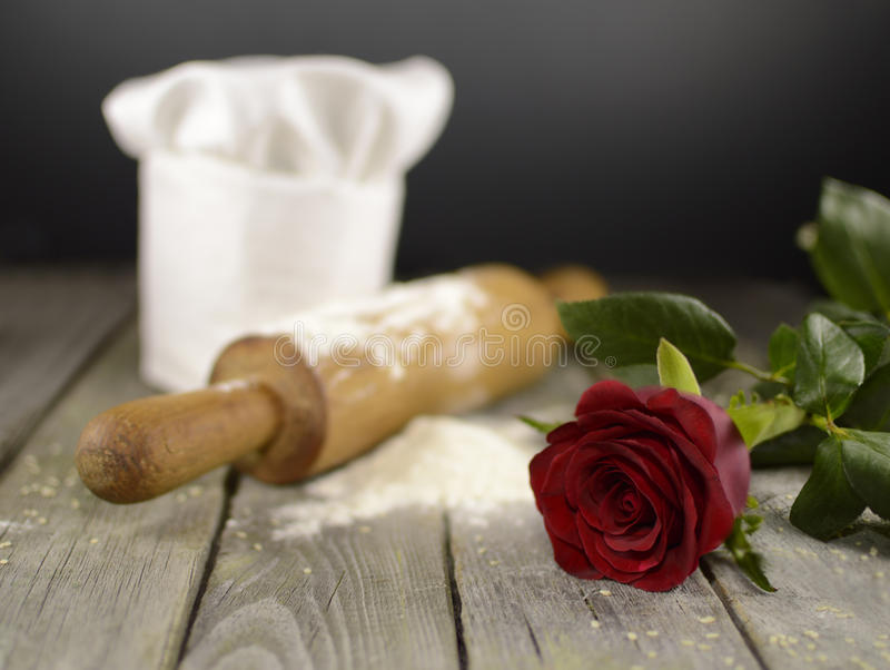 Chef's toque with red rose royalty free stock photo
