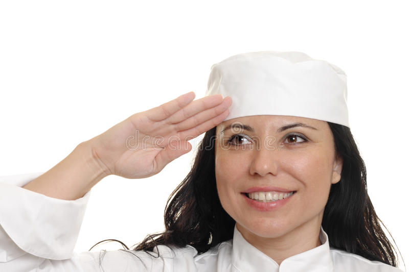 Chef Saluting. A female chef or student chef in uniform saluting. White background royalty free stock photos