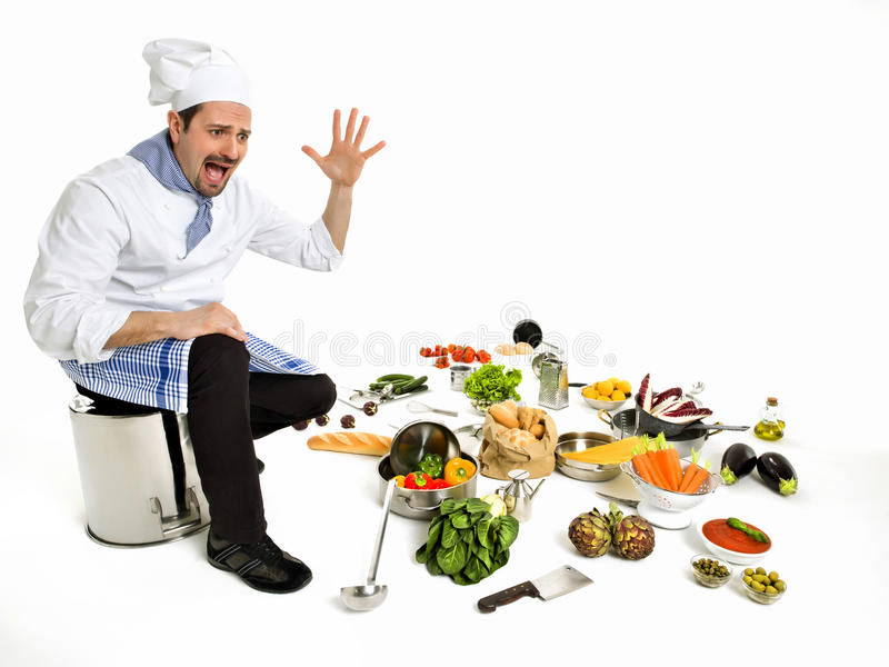 Chef scared seeing all the ingredients of his new recipe. Chef scared seeing all the ingredients to create a new recipe stock image