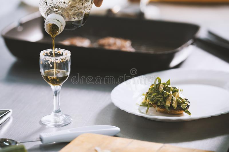 Chef serves food on the plate in restaurant stock images