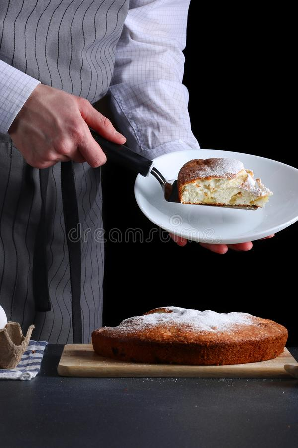 Chef serves the pie on dark background. pie recipe concept royalty free stock photos