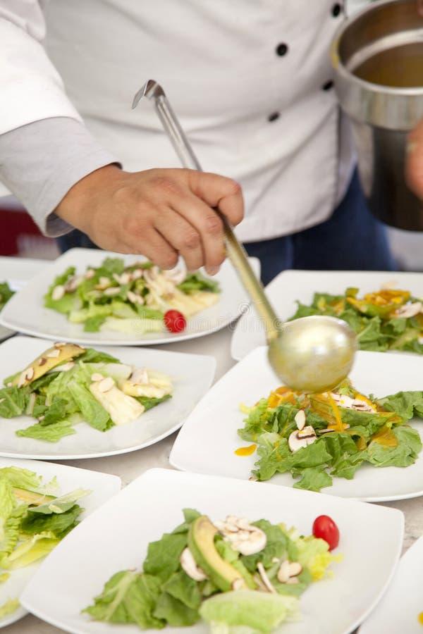 Chef serves salad stock image