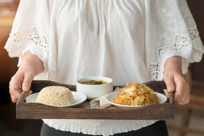 Chef serving brown rice and vegetarian food royalty free stock image
