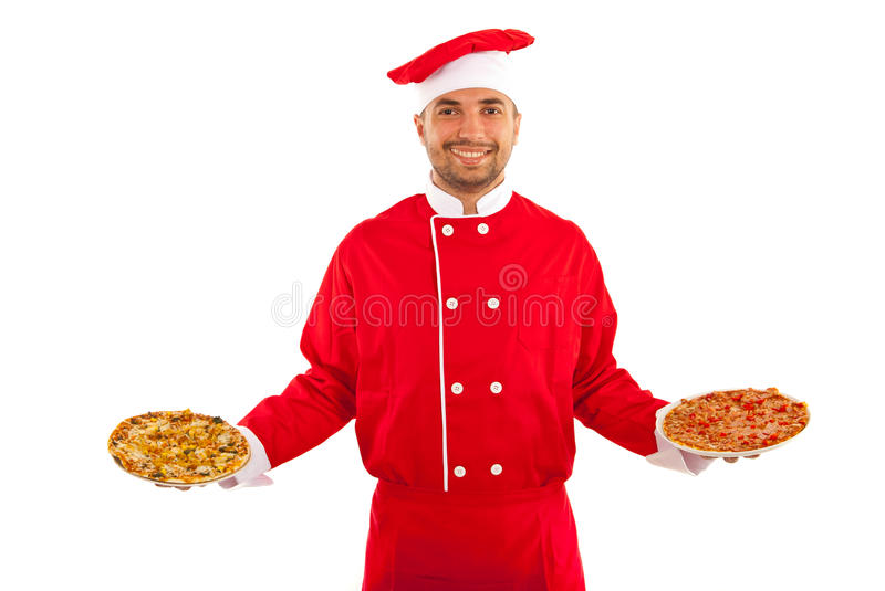 Chef serving pizza. Happy chef male serving pizza isolated on white background stock photo