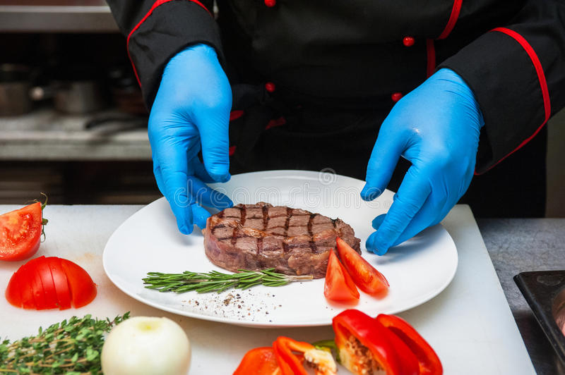 Chef set grilled meat. Steak on the plate royalty free stock photo