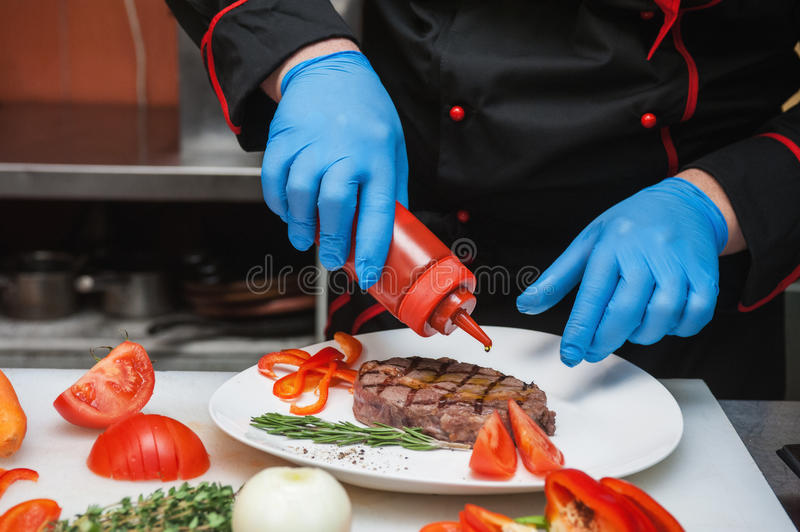 Chef set grilled meat. Steak on the plate stock image
