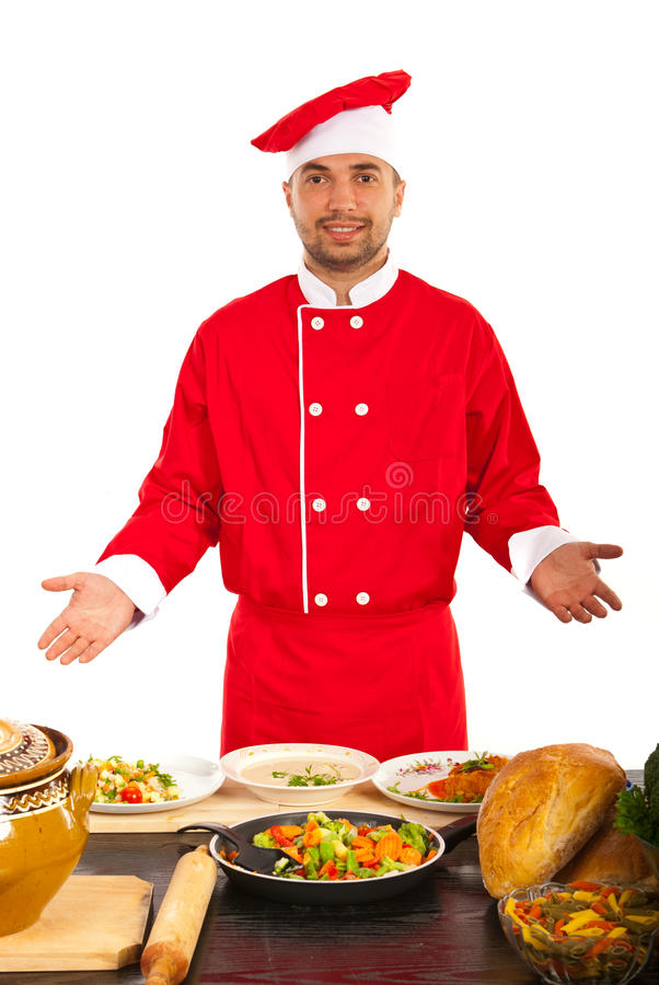 Chef showing his work. Chef showing plates with different food on table royalty free stock photo
