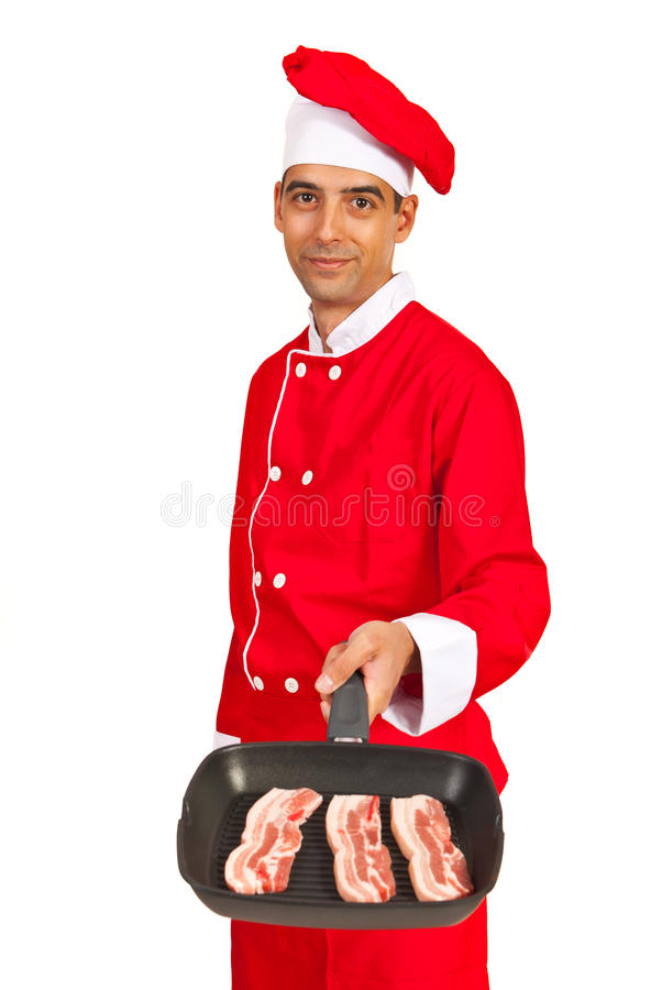 Chef showing meal grill royalty free stock photo