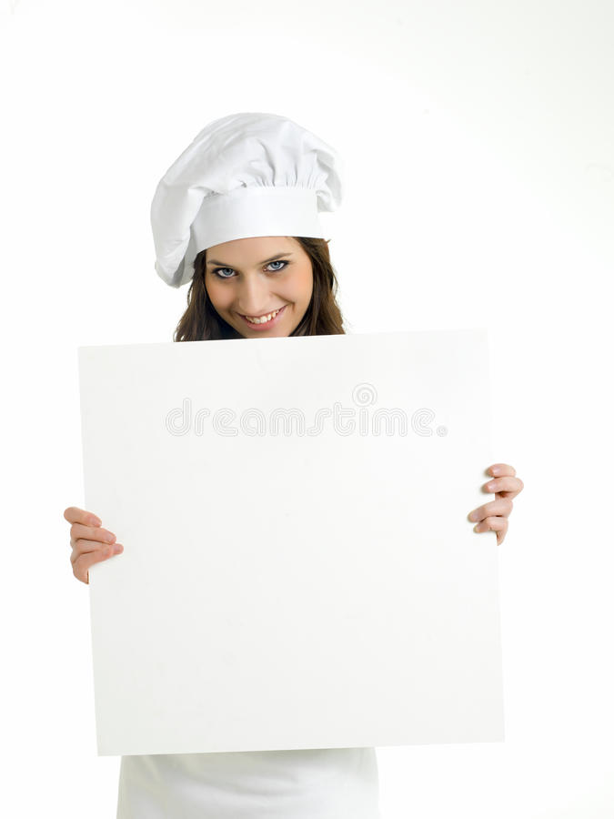Woman chef showing empty menu. A portrait of a smiling young woman chef showing an empty menu on a white background royalty free stock images
