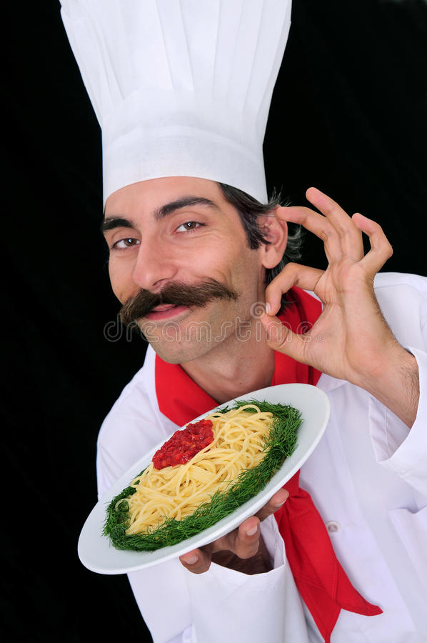 A Chef Showing Pasta Royalty Free Stock Photos