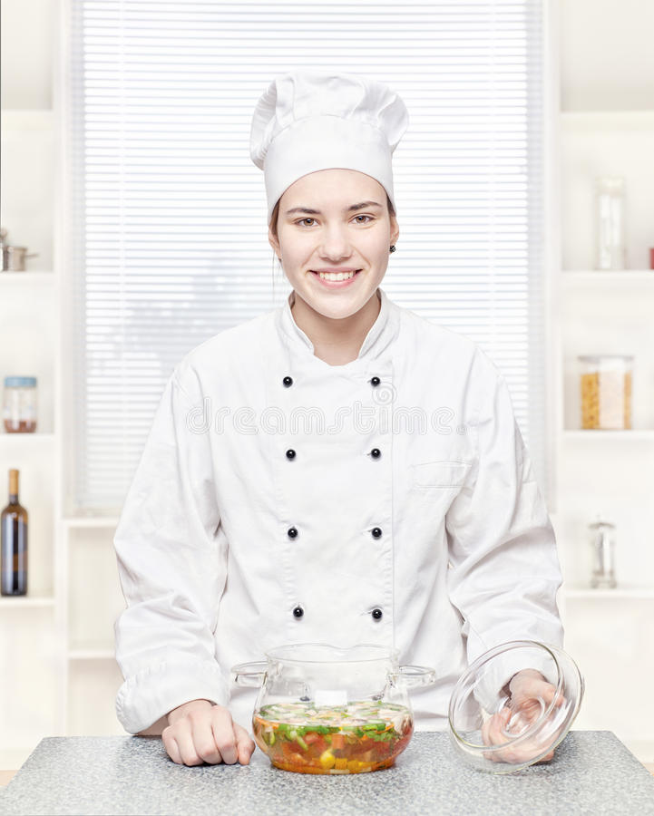 Download Chef With A Soup Of Vegetables In A Glass Pot Stock Photo - Image: 24363794