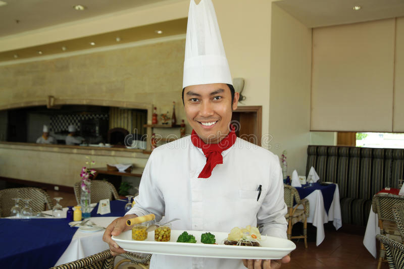 Chef standing at restaurant stock images