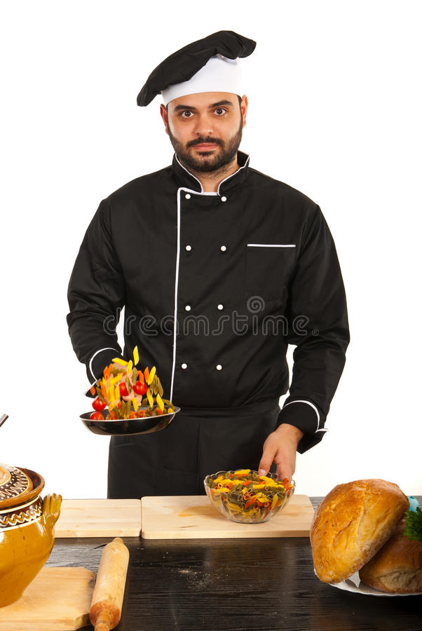 Chef throwing macaroni. Chef male throwing macaroni in kitchen against white background stock photos