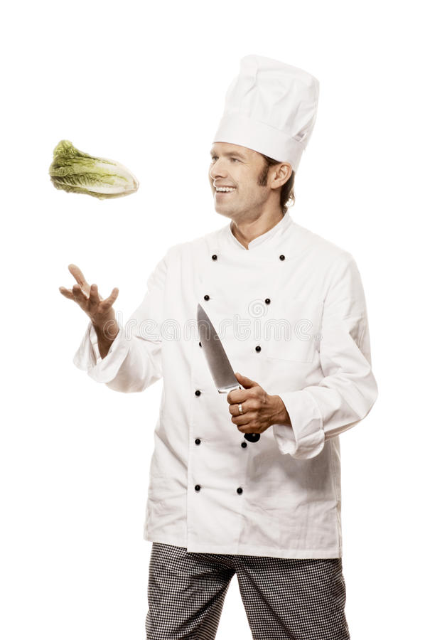 Chef serie. Chef throwing a salad in the air, isolated on white stock images