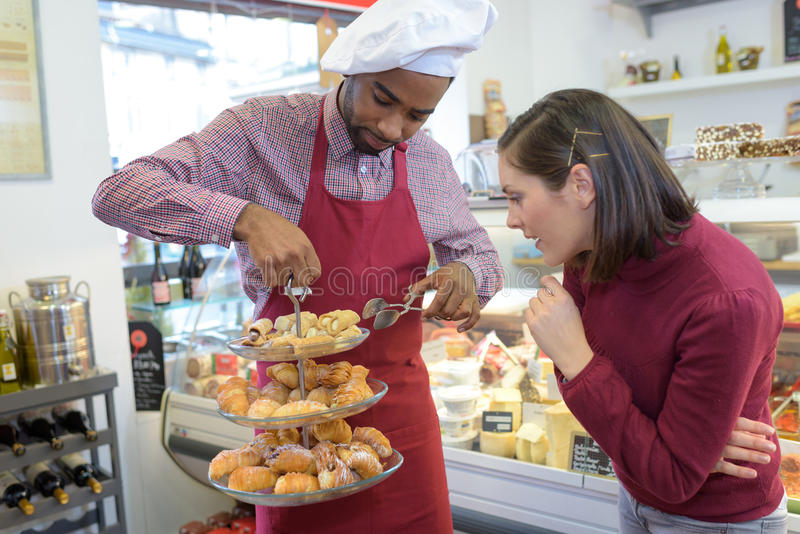 Chef with tiered display pastries. Chef with tiered display of pastries stock photos