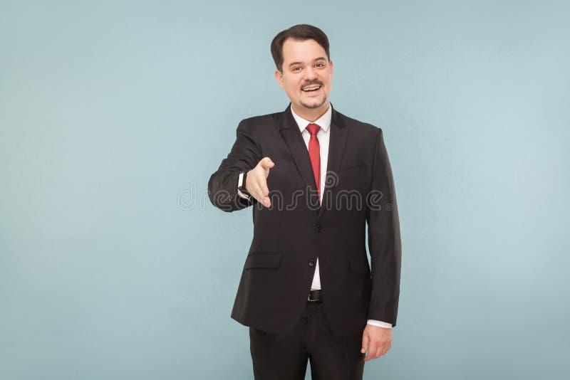 Chef- tonende handdruk, het toothy glimlachen royalty-vrije stock afbeelding