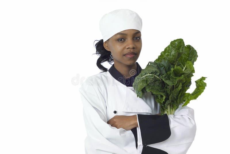 Chef und Spinat stockfotografie