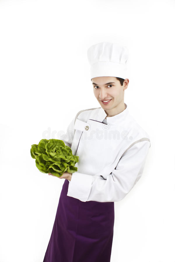 Chef with uniform and hat, holding lettuce royalty free stock photo