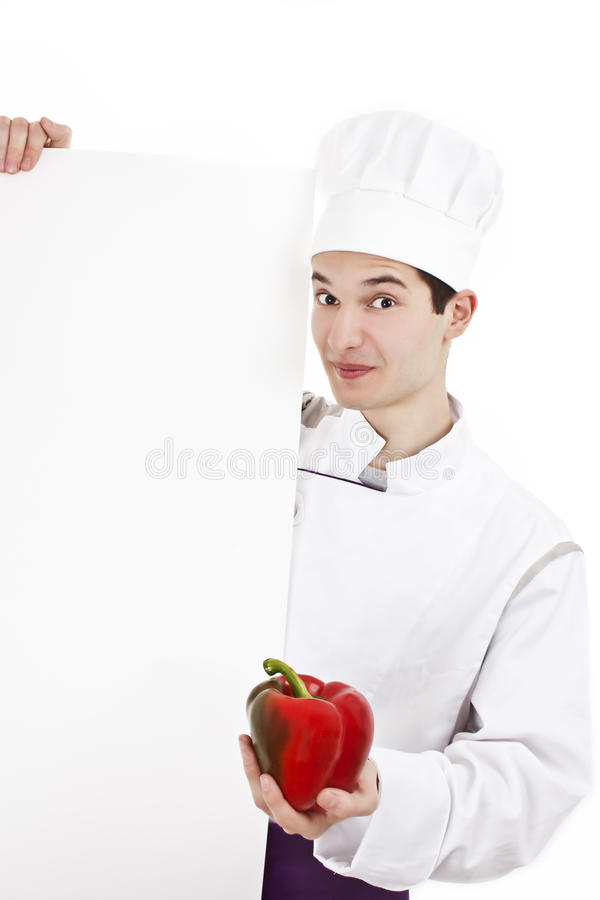 Chef with uniform and hat, holding peppers stock image