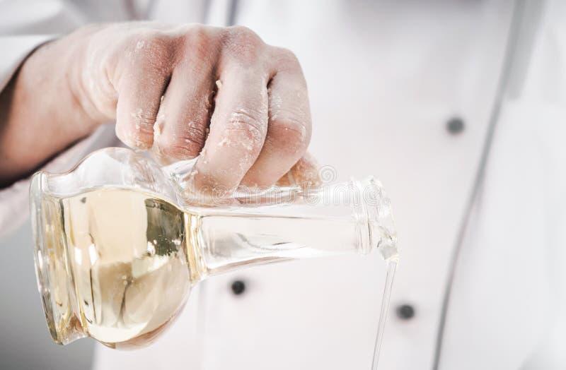 Chef Using Virgin Olive Oil stock photo